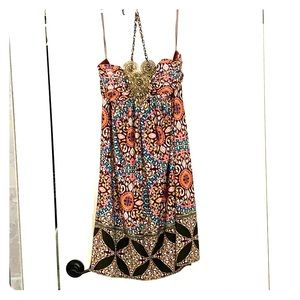 Adorable bohemian dress with metal accents on bust